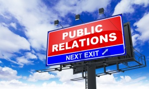 Public Relations - Red Billboard on Sky Background. Business Concept.